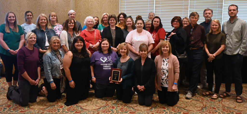 "SICHC staff with Dr Yolanda Yoder holding the IRHA's ""Doc Hollywood"" award"